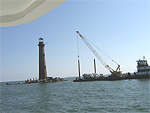 Barge with 3 cement trucks approach Sand Island Light
